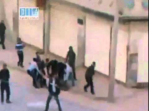20110427 - Homs City - Group of shabiha members runs to a wounded protester then start beating him