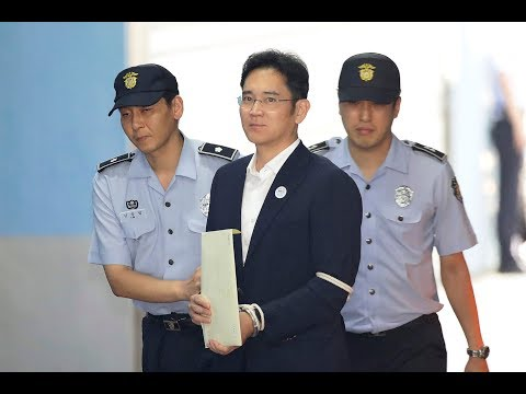 Billionaire Samsung chief found guilty of bribery and sentenced to 5 years in jail