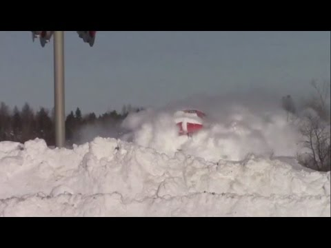 Thumbnail: Train plows through heavy snow