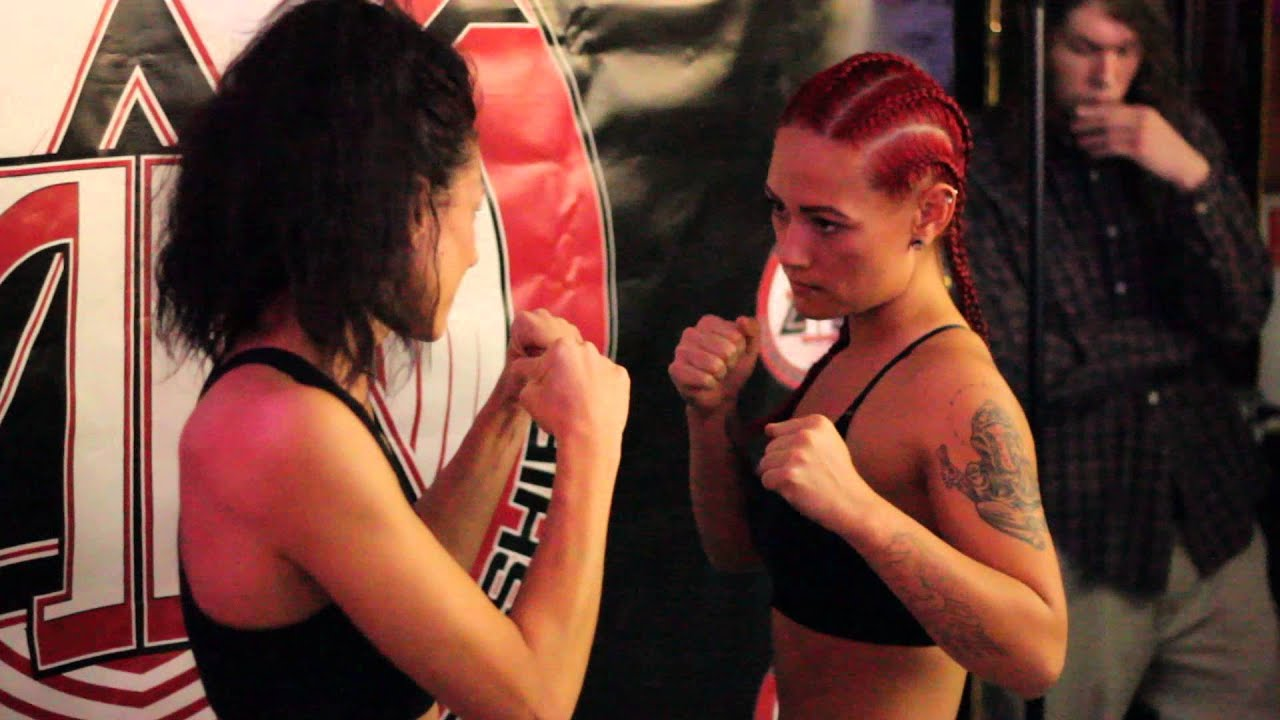 female boxing face pain