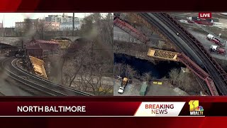 Crews investigate train derailment in Baltimore