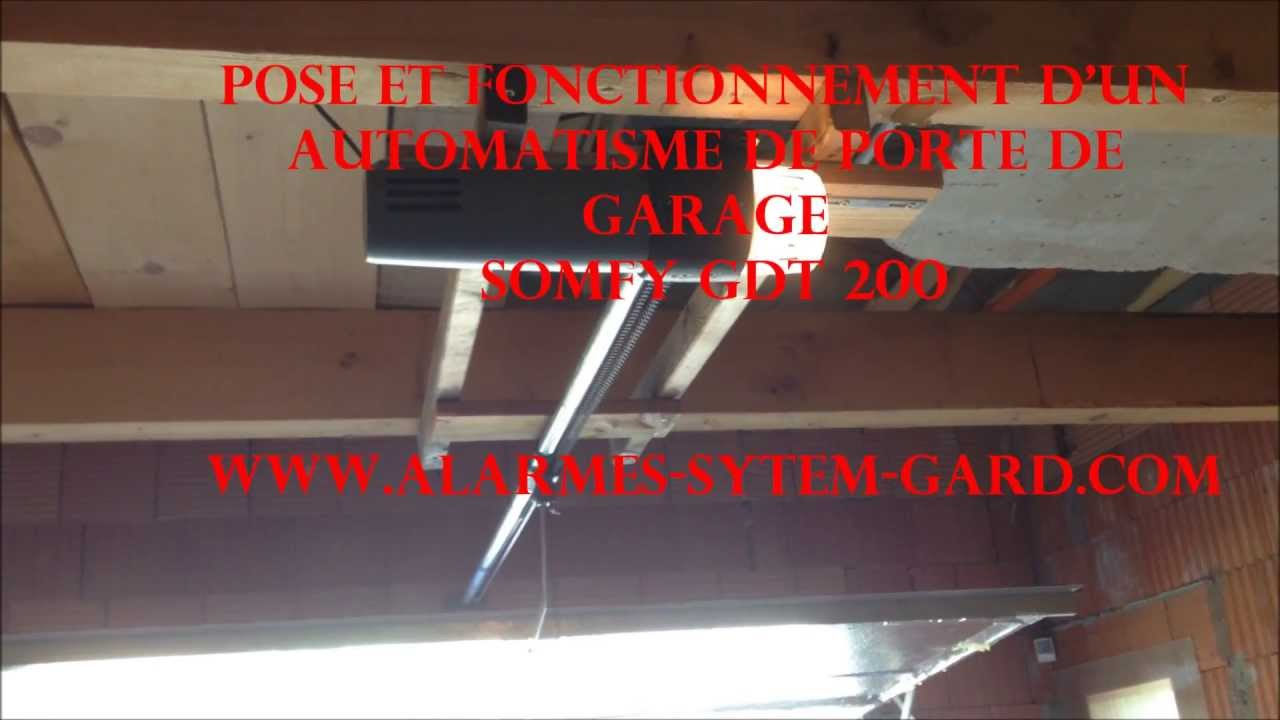 Pose et fonctionnement d 39 un automatisme de porte de garage somfy gdt 200 youtube - Porte de garage motorisee somfy ...
