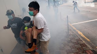 video: Police fire tear gas as thousands protest in Hong Kong over proposed security laws