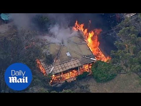 Bushfires in Victoria destroy homes and burn through National Park