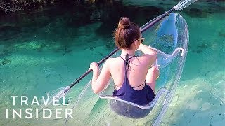 Ride Transparent Kayaks Over Crystal Clear Water thumbnail