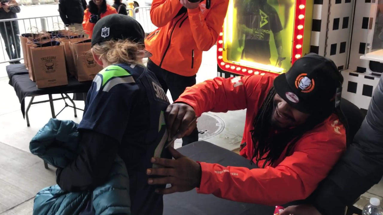 san francisco 42c83 343cf Marshawn Lynch signing the Skittles Jersey at Amazon Treasure Truck