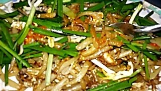 Asian Street Food - Fried Noodles With Eggs And Beef On A Phnom Penh Street