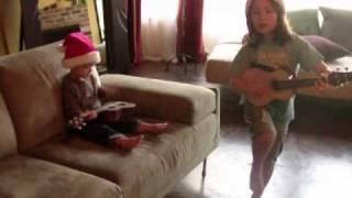 Jingle Bells on ukulele; sung in English, Hawaiian & Japanese