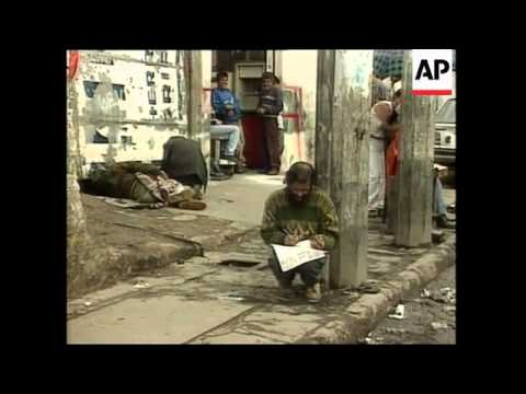 Peru: Straw Hut Settlement, South Africa: Begging In Streets, Colombia: Poor District