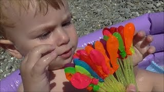 Baby play with Water Balloons toys