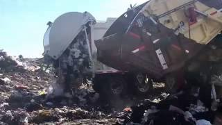Garbage Trucks Unloading At The Dump