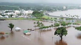 Neighborhoods flood and burn as hurricane pummels Hawaii