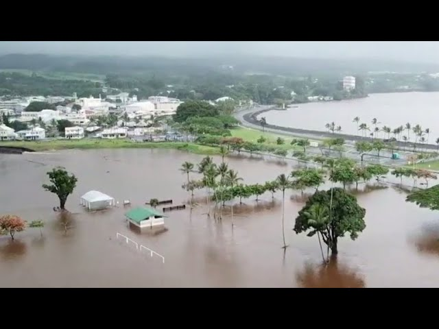 Neighborhoods flood and burn as hurricane pummels Hawaii