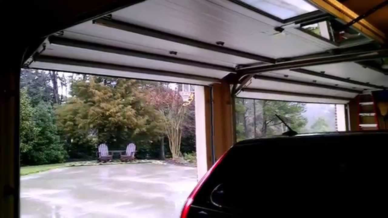 Garage door opening and closing youtube for Garage door not opening or closing