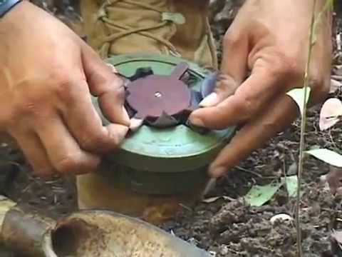 Crazy Asian diffuses landmine with his pocket knife