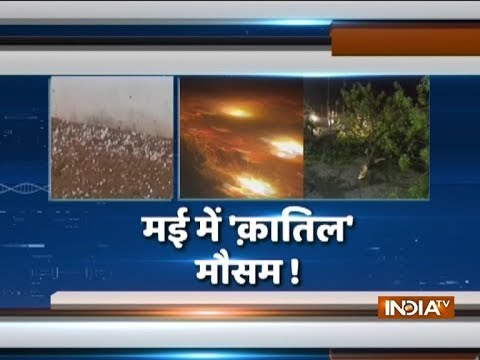 Many dead as sudden rain and dust storm strike North India