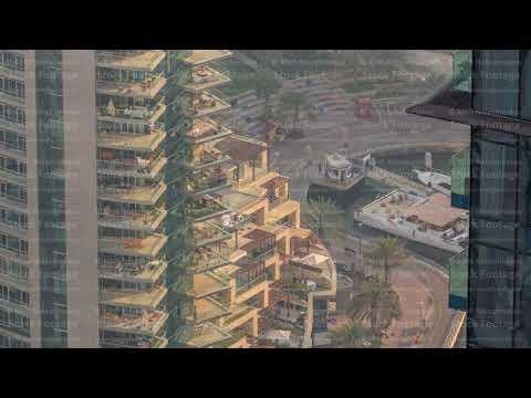 Dubai Marina waterfront with promenade aerial timelapse, Dubai, UAE.