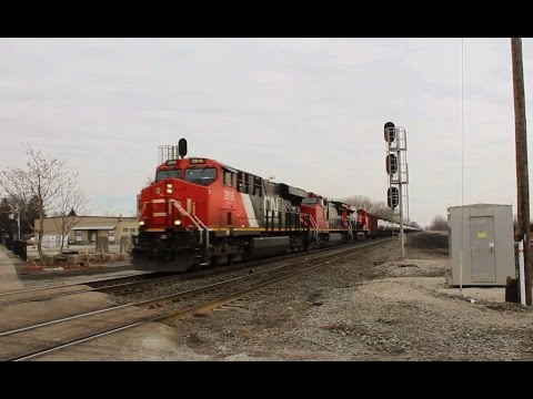 A pair of newish CN GEVO's & Dash 8W split the signals while heading east w/ an Empty Oil Train