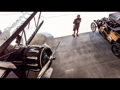 A hangar full of antique airplanes are this duo's labor of love