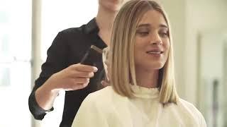 A cute girl got bob haircut at salon