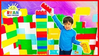 Ryan builds the tallest giant Lego tower challenge vs mommy!