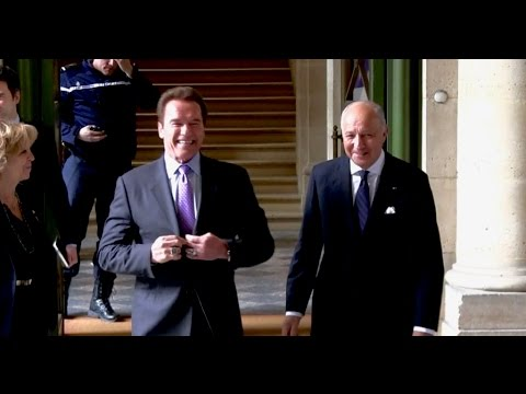 EXCLUSIVE: Arnold Schwarzenegger meets minister Laurent Fabius for the R20 Environnement meeting