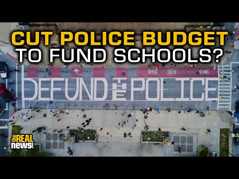 Activists Paint 'Defund Police' In Front Of Baltimore City Hall