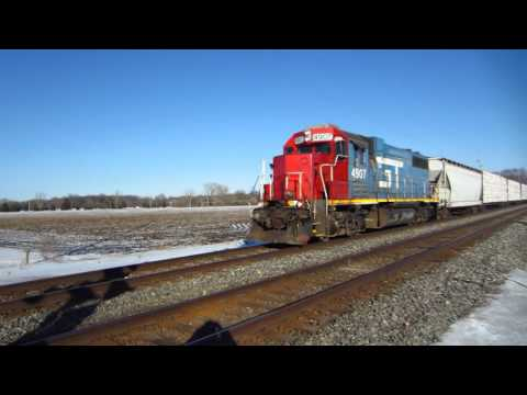 Grand Trunk Western GP38-2 #4907 rolls by with the local train