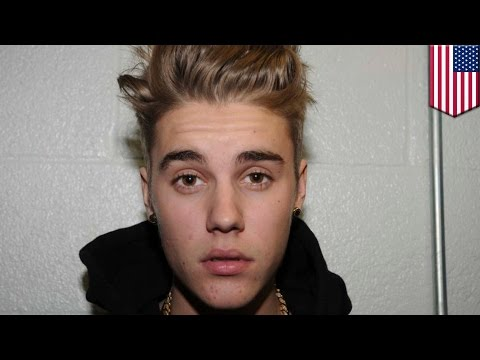 Justin Bieber involved in ANOTHER fight. Pop star arrested again after crashing ATV into minivan, September 3, 2014 - TomoNews US  - _eUpip_dI74 -