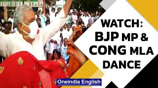 BJP's Kirodi Lal Meena & Congress' Indira Meena defy Covid rules at a wedding | Watch |Oneindia News