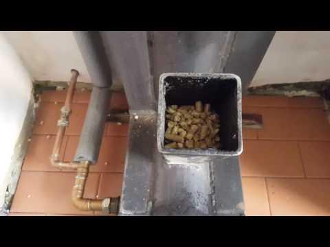 rocket stove, Gravity fed pellet burner Heats a 300 ltr water tank