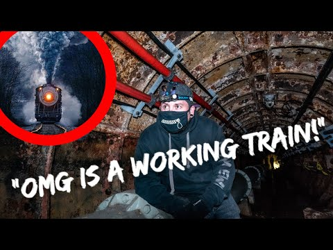 CRAZIEST UNDERGROUND EXPLORE YET! A WORKING TRAIN SURPRISES US!