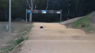3 5yr old peddling the bmx track on byk e 250 bike