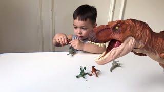 Father & Son unbox Tyrannosaurus Rex Thrash N Throw from Jurassic World