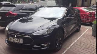 Tesla Model S in Kiev, Ukraine(Came across this awesome Tesla Model S in Kiev, Ukraine whilst my girlfriend and I walked around the city. Didn't realise the owner was chilling in the drivers ..., 2016-06-24T11:49:08.000Z)