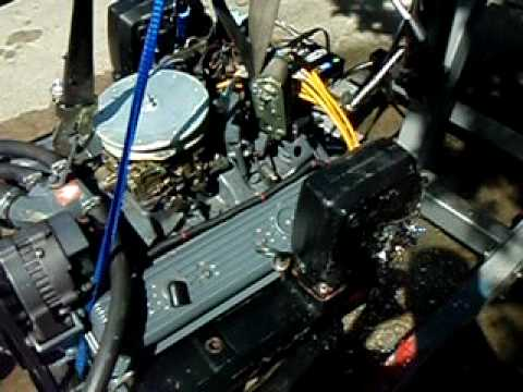 OMC Cobra 350 57 marine boat engine test run on makeshift