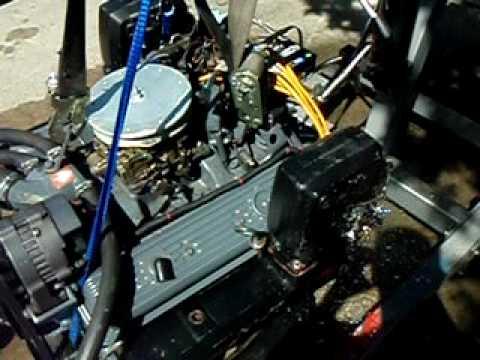 OMC Cobra 350 57 marine boat engine test run on makeshift
