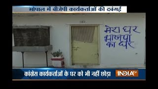 MP: BJP workers write party slogan outside Congress Leader