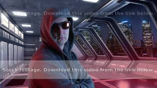 Man in black hood and sunglasses looking to night city from futuristic room. Man watching lighting