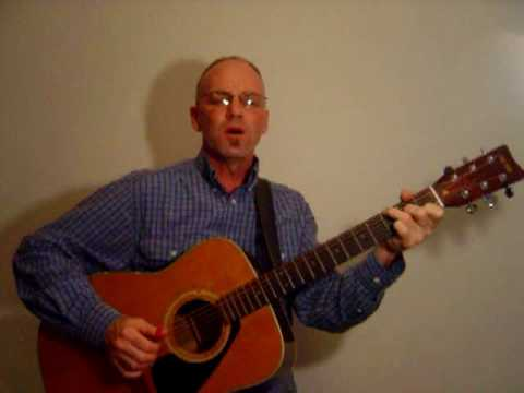 Blue Moon of Kentucky on acoustic guitar
