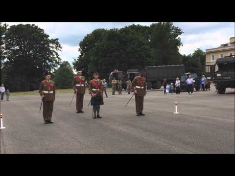 Academy Company Sergeants Major demonstrate marching with a pace stick