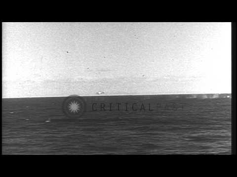 A British Pom Pom gun shoots down an enemy aircraft in the Atlantic Ocean during ...HD Stock Footage