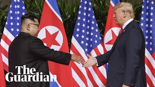 Moment Kim Jong-un and Donald Trump share historic handshake