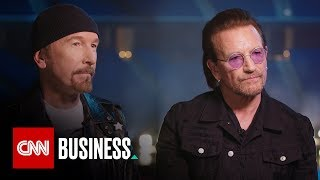 U2 band members Bono and The Edge sit down with CNNMoney's Laurie S...