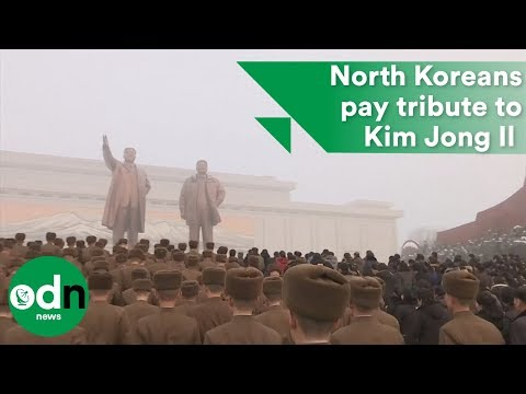 North Koreans head out in snow to pay tribute to former dictator Kim Jong Il