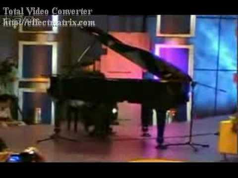 jay chou playing bu neng shuo de mi mi on piano