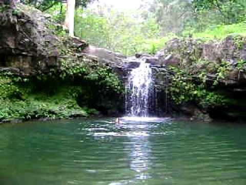 Jumping off a small waterfall in Maui