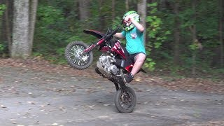 Kid on his pitbike and dirtbike We fixed the ssr140 and talking yz125, much more fun..