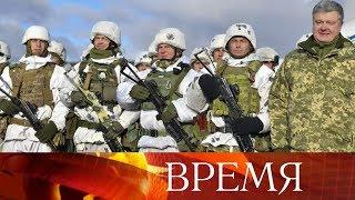 Президент Украины Петр Порошенко сфотографировался с солдатом, носящим эмблему СС.
