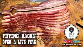 Frying Homemade Bacon Over a Live Fire